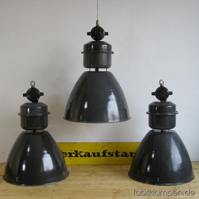 Huge industrial lamps. Material: black (grayish) enameled sheet, aluminium. The lamps are cleaned, and newly electrified, with E40 sockets -  adapters for E27 are inclusive, so the lamps can be used with E27 bulbs. Total height: ca. 76 cm (30 inches). Diameter of the shade ca. 53 cm (21 inches).