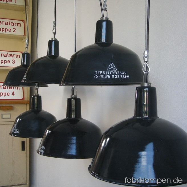 Gray industrial lamps with inscription in nice original condition. Material: gray (bluish) enameled sheet, with wire rope suspension. The lamps are cleaned and newly electrified, with E27 sockets. Total height: ca. 23 cm (9 inches). Diameter of the shade ca. 31 cm (12,2 inches). The lamps have safety grids with glass (last pictures).