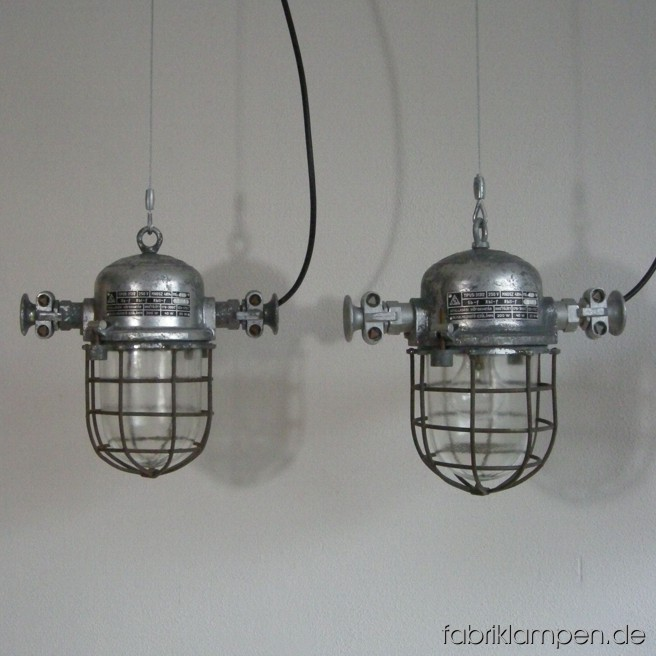 Nice industrial lamp (bully). Material: aluminum, steel, glass. We have 20 pieces on stock. The lamps are cleaned, and newly electrified, with ca. 2 m wire. Total height: ca. 30 cm (11,8 inches).