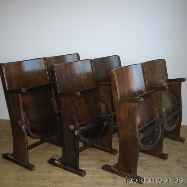 Old cinema chairs in very nice condition, made of oak and plywood. Width 106 cm (42 inches), height 83 cm (33 inches), sitting height 40-46 cm (16-18 inches).