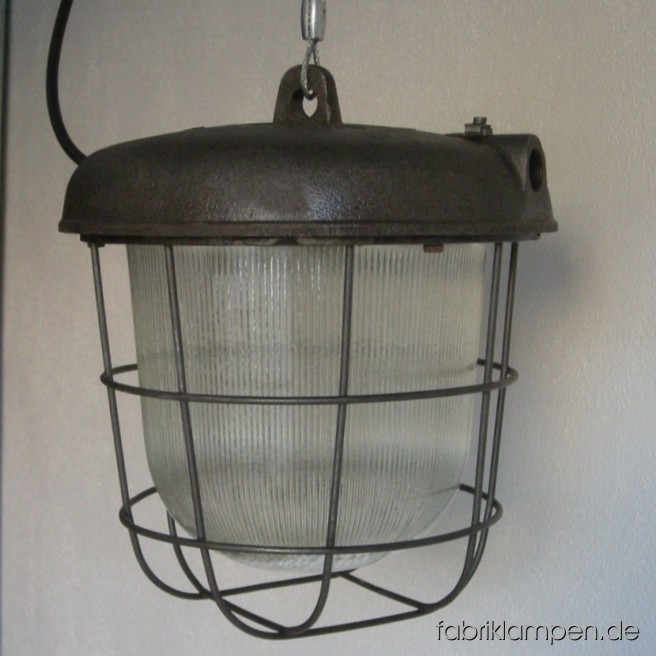 Nice industrial bunker lamp (bully). Material: casted iron, steel, glass. We have 10 pieces on stock. The lamps are cleaned and newly electrified, with ca. 2 m wire. Total height: ca. 30 cm (11,8 inches).