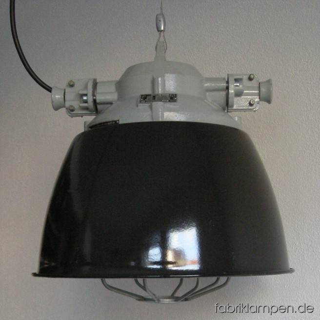 Black industrial lamps with enameled shades. Material: black enameled sheet, aluminium head. Newly electrified, with E27 sockets. Height of the lamps ca. 39 cm (15,4 inches), diameter of the shades ca. 39 cm (15,4 inches).