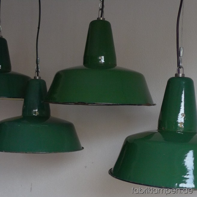 Green industrial lamps. Material: green enameled sheet. Newly electrified, with wire-rope suspension. Height of the lamp is ca. 30 cm (11,8 inches), diameter of the shade is ca. 41 cm (16 inches).