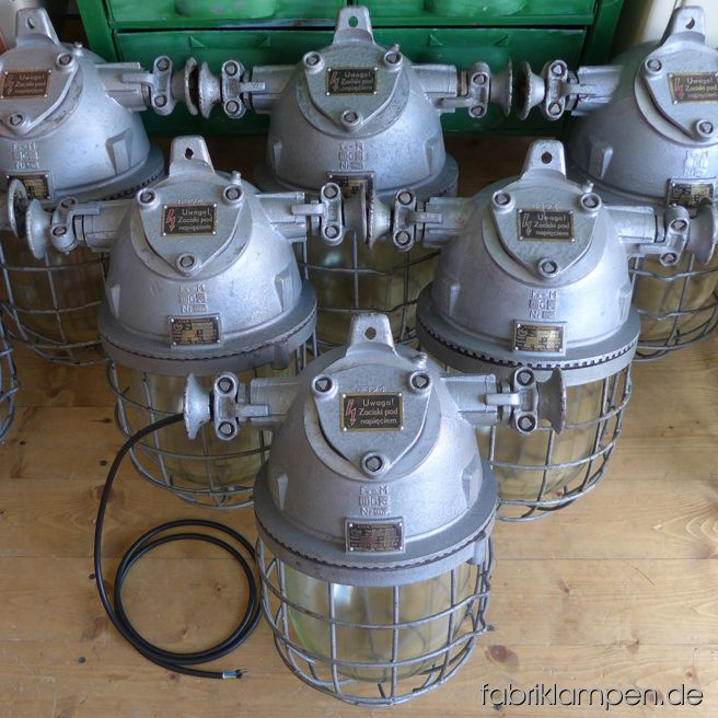 "Rare pale gray bunker lamps. Material: gray varnished casing, safety glass and grid.  Newly electrified, with E27 sockets. We have 12 pieces on stock. Height of the lamps ca. 46 cm (18,1 inches), diameter of the lamps (without ""ears"") ca. 28 cm (11 inches)."