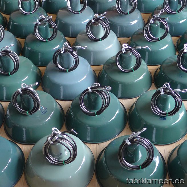 Nice collection of green enamel lamps for a restaurant in Osnabrück.