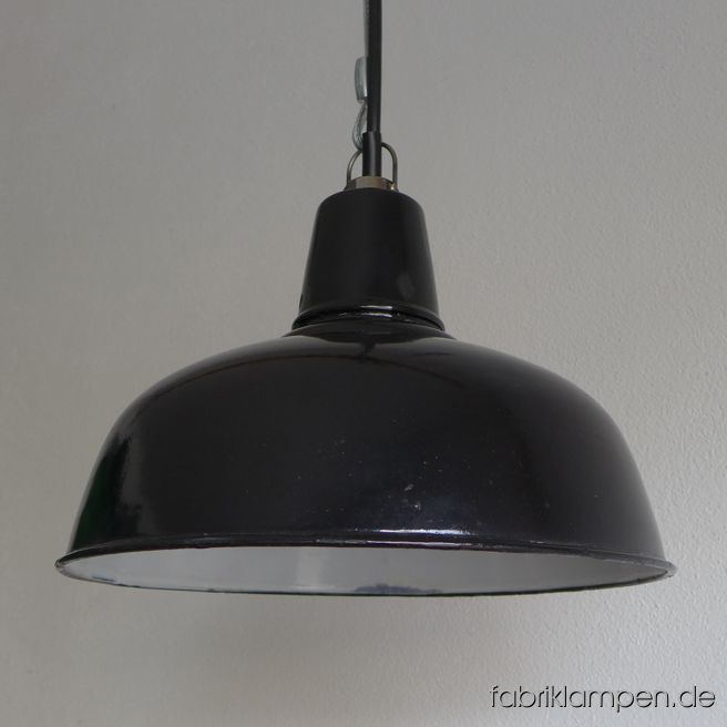 Old black enamel factory lamp from the 1930ies. We have 4 pieces in stock. The lamps have the typical traces of usage and age. Material: black (inside white) enameled steel sheet. Newly electrified, with E27 sockets. We have only 4 pieces on stock. Height of the lamps ca. 23 cm (9 inches), diameter of the shades ca. 35 cm (13,8 inches).