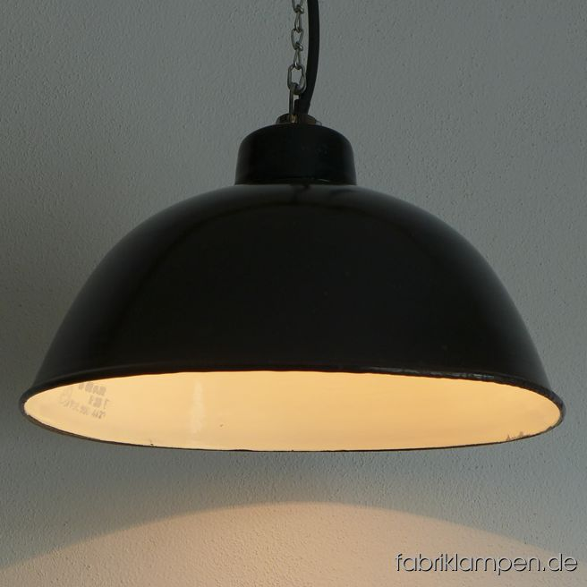 Old black LBL enamel factory lamp, produced by VEB Leuchtenbau Leipzig. The lamps have the typical traces of usage and age. Material: black (inside white) enameled steel sheet. Newly electrified, with E27 ceramic sockets. Height of the lamps ca. 22 cm (8,8 inches), diameter of the shade ca. 38 cm (15 inches).