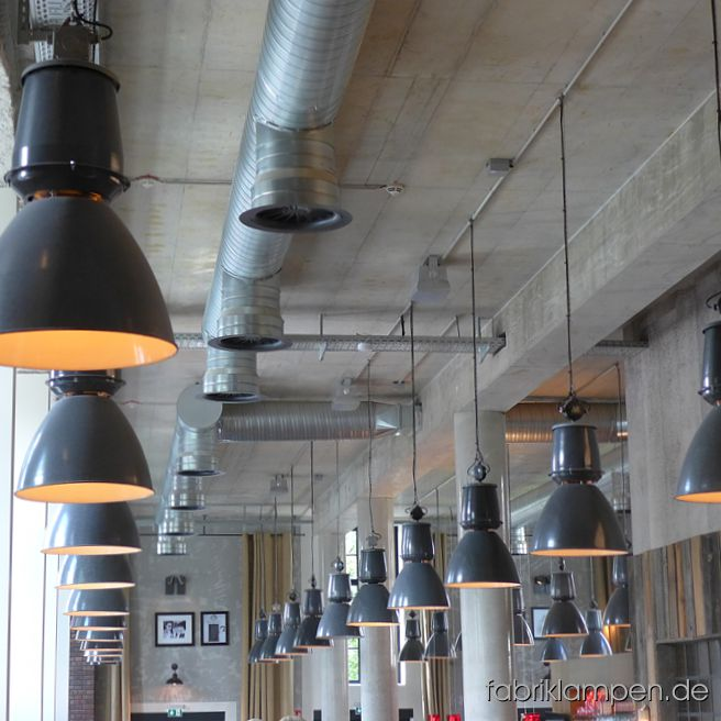 Impressions of June 2016: factory lamps supplied to Northern Germany, on the way back a cup of cappuccino in Lower Saxony with lamps from fabriklampen.de. Casted iron lamp heads with chain suspensions, lamp scizzors, old window shutters packed on pallet, lamps arriving to the building site.