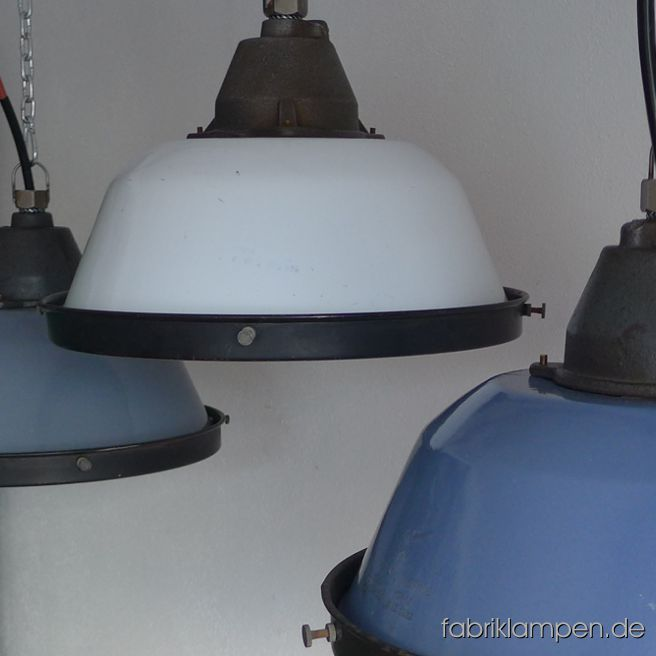 Old enamel factory lamps with safety grid and glass. We have these lamps in gray, blue and white and in mixed colours (bluish gray or grayish blue). The lamps have the slight traces of usage and age. Material: casted iron top, gray, blue or white (inside white) enameled steel sheet. Cleaned, newly electrified, with E27 ceramic sockets. We have 80 pieces in stock. Height of the lamps ca. 23 cm (9 inches), diameter of the shades ca. 36 cm (14,2 inches), diameter with safety grid 37 cm (14,6 inches).