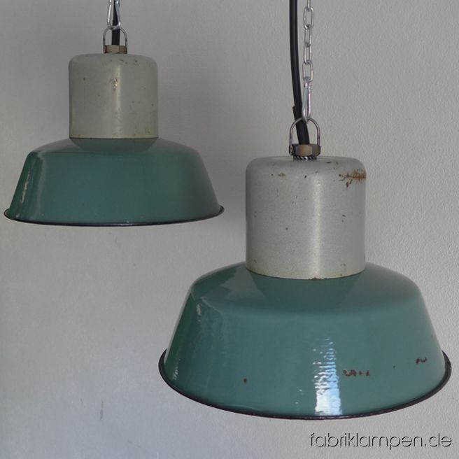 Old turquoise enamel factory lamps. The lamps have the strong traces of usage and age. Material: steel top, turquoise (inside white) enameled steel sheet. Cleaned and newly electrified, with E27 ceramic sockets. We have 7 pieces on stock. Height of the lamps ca. 23 cm (9 inches), diameter of the shades ca. 32 cm (12,6 inches).