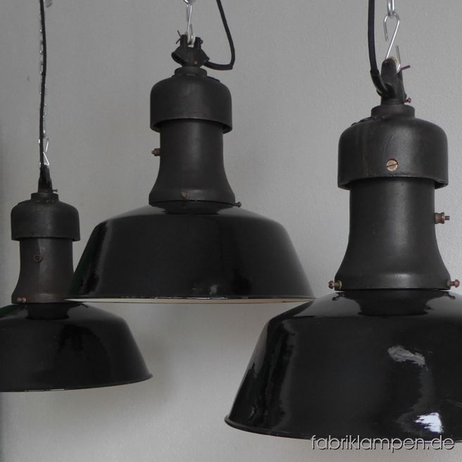 Very rare old industrial lamps produced by Rech. The lamps have the strong traces of usage and age. Material: casted iron top with original brass screws, black (inside white) enameled steel sheet. Newly electrified, with E27 ceramic sockets. We have only 2 pieces in stock. Height of the lamps ca. 43 cm (17 inches), diameter of the shades ca. 40 cm (15,7 inches).