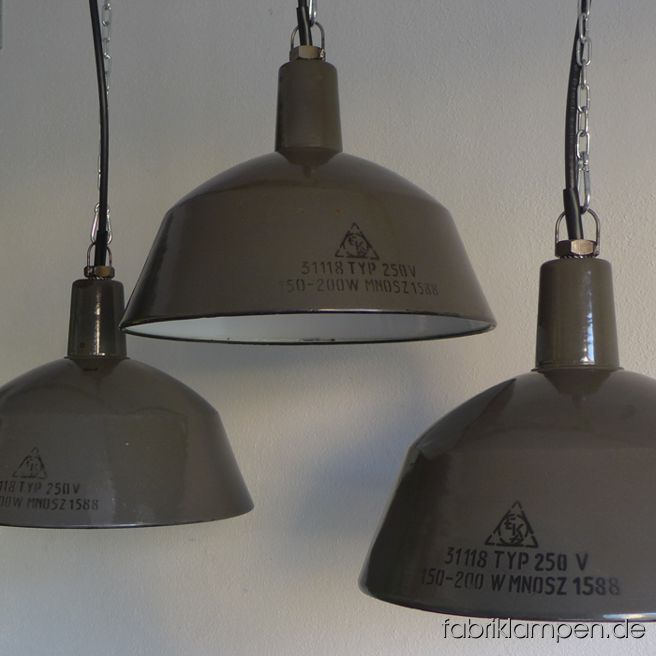 Old brown enamel industrial lamps with black inscriptions. The lamps have the traces of age and usage. Material: brown (inside white) enameled steel sheet. Cleaned, newly electrified, with E27 porcelain bulbholders. Height of the lamp is ca. 26 cm (10,2 inches), diameter of the shade is ca. 35 cm (13,8 inches).