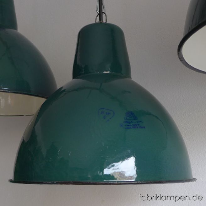 Rare old green enamel lamp. These lamps belong to the biggest old green enamel lamps ever. The old factory lamps have the traces of usage and age. Material: green (inside white) enameled steel sheet. Clenad and newly electrified, with E27 ceramic bulbholders. Height of the lamps ca. 37 cm (10,6  inches), diameter of the shades ca. 42 cm (16,5 inches).