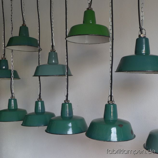 Rare old green factory lamps in various shades of colour (leaf green, emerald, moss-green, patina green, pale green, yellow green etc.). The old industrial  lamps have the traces of usage and age. Material: green (inside white) enameled steel sheet, mostly hallmarked. Cleaned and newly electrified, with E27 ceramic bulbholders and 2 matres textile cable. Height of the lamps ca. 13 cm (5,1  inches), diameter of the shades ca. 25 cm (9,8 inches).