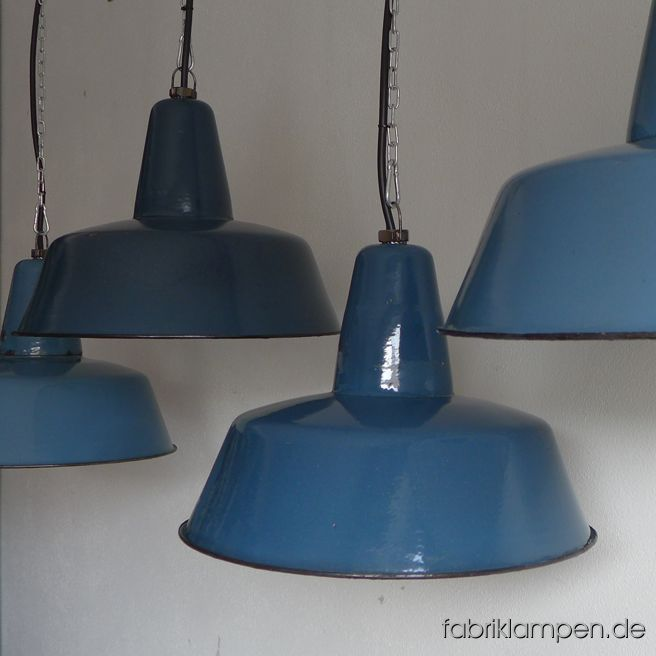 Rare old blue enamel lamps in various shades of blue. Material: blue (inside white) enameled steel sheet. These old industrial lamps have the traces of usage and age. They are cleaned, conserved, newly electrified, with new E27 bulbholders. Height of the lamp is ca. 30 cm (11,8 inches), diameter of the shade is ca. 41 cm (16 inches).