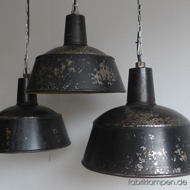 Rare old black industrial lamps from the 1930ies, 1940ies. Originally warnished, greatly weathered in the last decades. These old industrial lamps have the massive traces of usage and age. Material: black (inside white) enameled steel sheet. Cleaned and newly electrified, with E27 ceramic bulbholders. Height of the lamps ca. 32 cm (12,6  inches), diameter of the shades ca. 41 cm (16,1 inches).