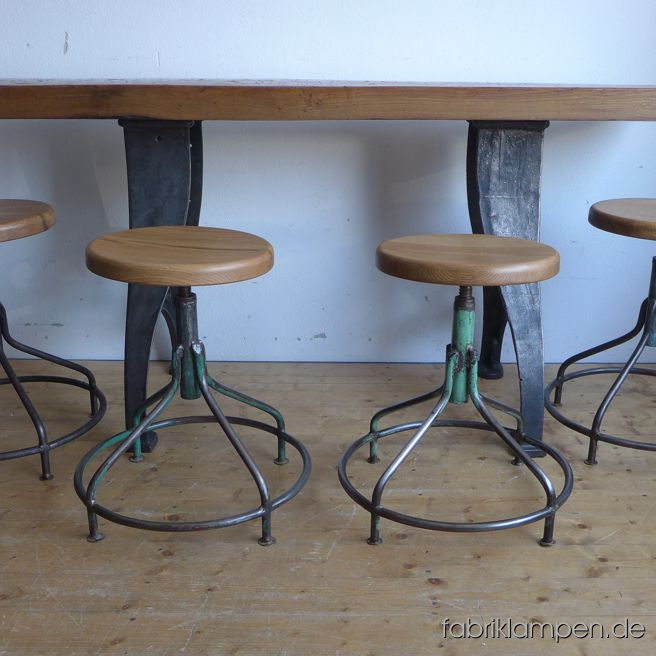 Very nice old industrial stools with oak sits. The pedestals are cleaned and conserved (here and there with remains of original colour like blue or green). Similar chairs in original condition on the last photo. These old stools became new oak sits, they are waxed. The oak massive sits are 3,8 cm (1,5 inches) thick, their diameter amount to 35 cm (13,8 inches). Everlasting, suitable for gastronomy or for your loft-kitchen. Sitting height from 54 to 67 cm (21,25 – 26,4 inches)