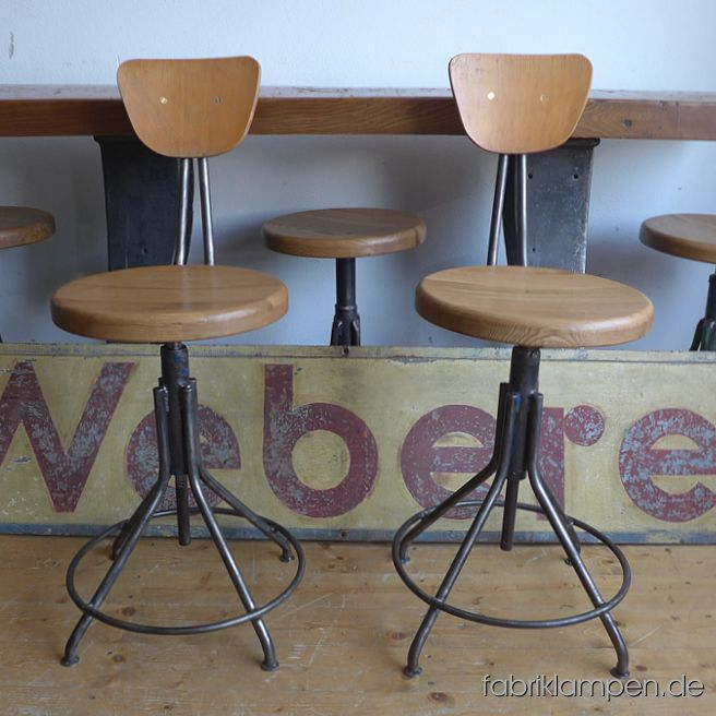 Very nice old industrial chairs with oak sits. The pedestals are cleaned and conserved (here and there with remains of original colour like blue or green). These old chaird became new oak sits, they are waxed. The oak massive sits are 3,8 cm (1,5 inches) thick, their diameter amount to 35 cm (13,8 inches). Everlasting, suitable for gastronomy or for your loft-kitchen. Sitting height from 56 to 67 cm (22 – 26,4 inches)