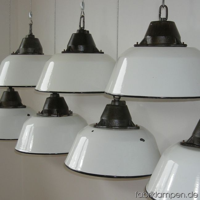 Industrial lamps with white enameled shades. Casted iron parts with wire rope suspension. Casted iron parts are cleaned and colorless varnished. Total height: as you wish (included in price up to 3 m). Height lamp ca. 23 cm (9 inches), diameter of the lamp ca. 36 cm (14,2 inches).