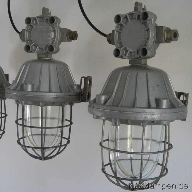 Nice industrial bunker lamps. Material: aluminium, steel, glass. The lamps are cleaned, and newly electrified, with ca. 2 m wire. Total height: ca. 46 cm (18 inches), weight ca. 8 kgs.
