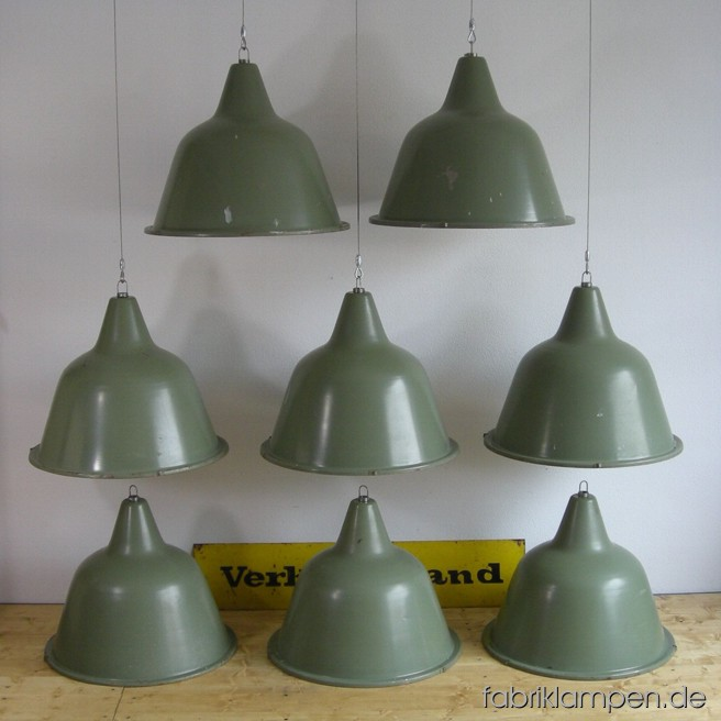Industrial lamps in pale green. Material: green painted sheet with wire rope suspension. Height lamps ca. 42 or (16,5 inches), diameter of the lamps ca. 54 cm (21 inches). With strong traces of age and use. For 20 EUR/piece additional price the lamps can be electrified.