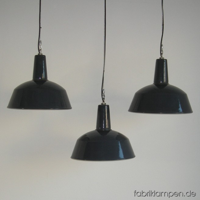 Gray industrial lamps with enameled shades in nice condition. Material: gray enameled sheet. Newly electrified, with wire-rope suspension. Height of the lamps ca. 33 cm (13 inches), diameter of the shades ca. 41 cm (16,1 inches).