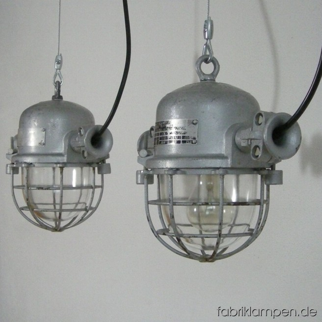 Nice small industrial lamp (bully). Material: aluminum, steel, glass. We have more than 80 pieces on stock. The lamps are cleaned, and newly electrified, with ca. 2 m wire. Total height: ca. 26 cm (10,2 inches).