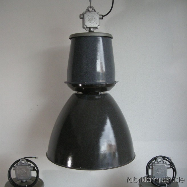 Gray industrial lamps with enameled shades. Material: gray enameled sheet, aluminium head. Newly electrified, with E40/E27 sockets. Height of the lamps ca. 84 cm (33 inches), diameter of the shades ca. 53 cm (21 inches).