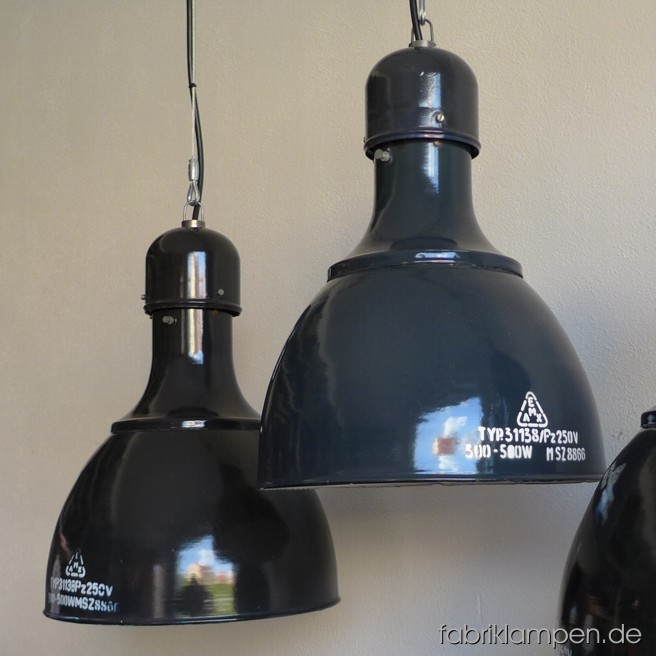 Very rare gray and black industrial lamps with enameled shades. Material: black or gray enameled sheet. The lamps are cleaned, newly electrified, mounted with with E40/E27 sockets. Height of the lamps ca. 47,5 cm (18,7 inches), diameter of the shades ca. 36 cm (14,1 inches).