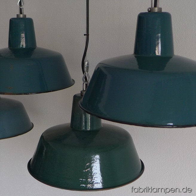 Green industrial lamps. Material: green enameled sheet. Newly electrified, with wire-rope suspension. Height of the lamp is ca. 21 cm (8,3 inches), diameter of the shade is ca. 33 cm (13 inches).