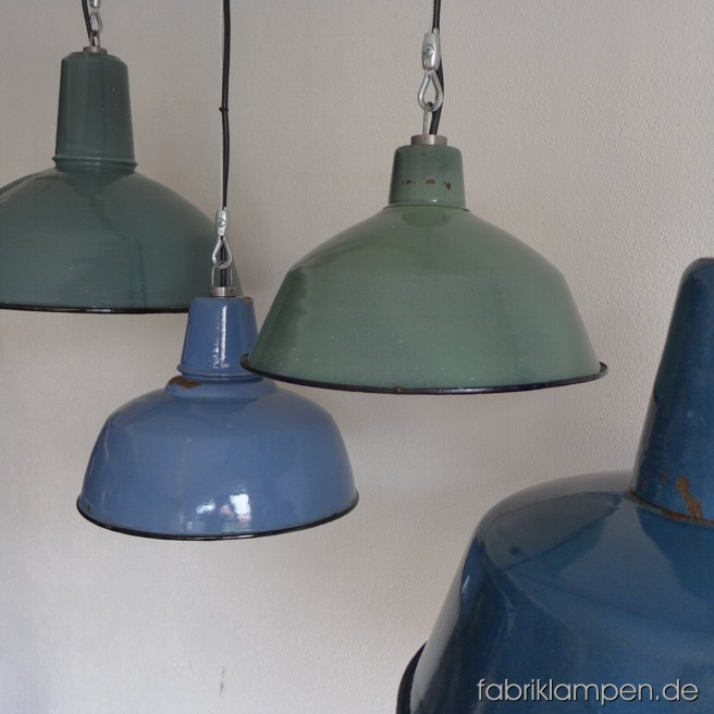 Green and blue industrial lamps with traces of time. Material: green or blue enameled sheet. Newly electrified, with wire-rope suspension. Height of the lamps is between 17-28 cm (6,7 - 11 inches), diameter of the shades is ca. 30-42 cm (11,8 – 16,5 inches).