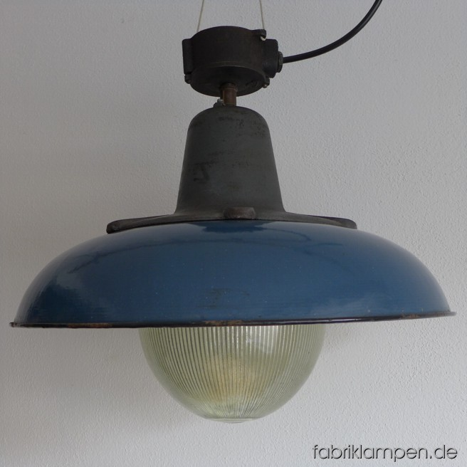 Very rare grave blue enamel lamp with casted iron top and massive glass bulb. It belongs to the biggest coloured enamel lamps , the diameter of the shade is 52 cm (20,5 inches), the lamp weighs 15 kgs. The lamp can be delivered either with the original distribution box or with tube-suspension with canopy.