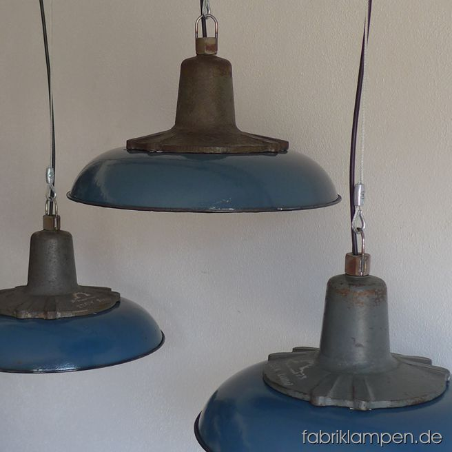 Nice blue industrial lamps with enameled shades. Material: blue enameled sheet, casted iron head. Newly electrified, with E27 sockets. We have over 30 pieces on stock. Height of the lamps ca. 20 cm (7,9 inches), diameter of the shades ca. 41 cm (16,1 inches).