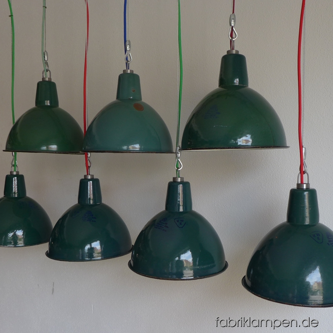 Green industrial lamps. Material: green enameled sheet, textile cable. Newly electrified, with wire-rope suspension. Height of the lamp is ca. 22 cm (8,7 inches), diameter of the shade is ca. 27 cm (10,6 inches).