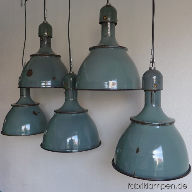 "Very rare green enamel lamps. The beautyful colour is green, with some turquoise and petrol. The lamps have a lot of traces of usage and age. Material: green enameled steel sheet. Newly electrified, with E27 sockets. We have 5 pieces on stock. Height of the lamps ca. 42 cm (16,5 inches), diameter of the shades ca. 36 cm (14,2 inches). Please note: the form of these lamps is very popular and these lamps will be produced again in Eastern-Europe (and offered as originals in various colours). The cheap ""fake""-lamps are not difficult to identify. These lamps, as all of our lamps, are of course originals of the time."