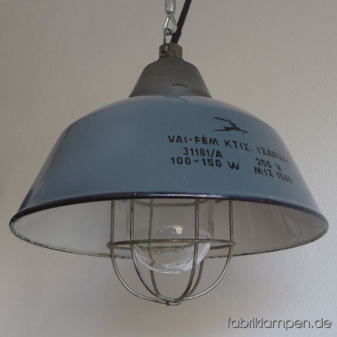 Old industrial lamp with gray (grayish blue) enameled shades. Material: gray enameled sheet, casted iron head, safety glass and steel grid. Newly electrified, with E27 sockets. We have 20 pieces on stock. Height of the lamps ca. 30,5 cm (12 inches), diameter of the shades ca. 36 cm (14,2 inches).