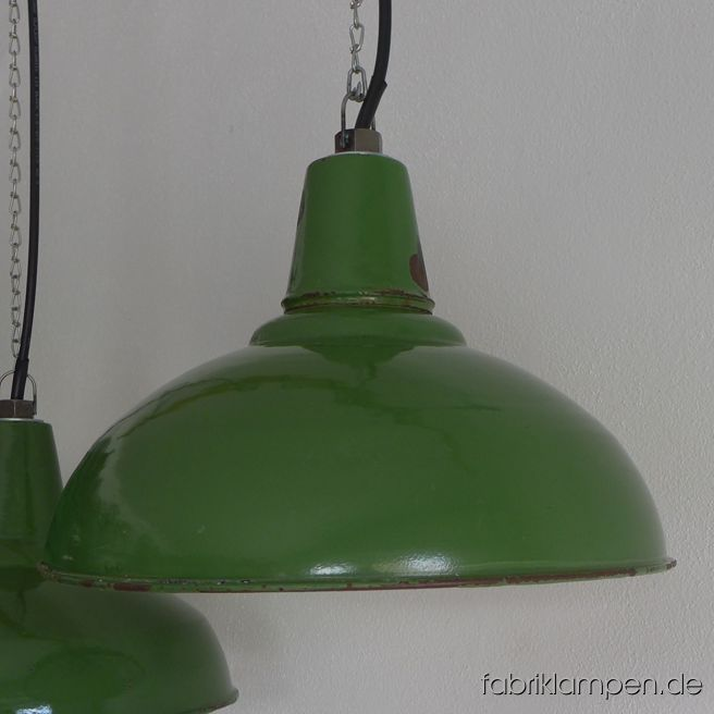 Old green enamel Art Deco factory lamps from about 1930, producer Karl Engel, Budapest. The lamps have the strong traces of usage and age. Material: black (inside white) enameled steel sheet. Newly electrified, with E27 ceramic sockets. We have only 2 pieces on stock. Height of the lamps ca. 27 cm (10,6 inches), diameter of the shades ca. 41 cm (16,1 inches).