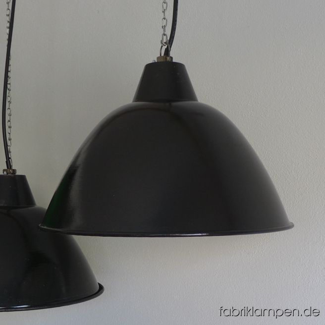 Old black enamel factory LBD lamp, producer LBD (VEB Leuchtenbau Dresden). We have 20 pieces in stock. The lamps have the typical traces of usage and age. Material: black (inside white) enameled steel sheet. Newly electrified, with E27 ceramic sockets. Height of the lamps ca. 30 cm (11,8 inches), diameter of the shades ca. 46 cm (18,1 inches) – we have also the smaller version of this type in stock.