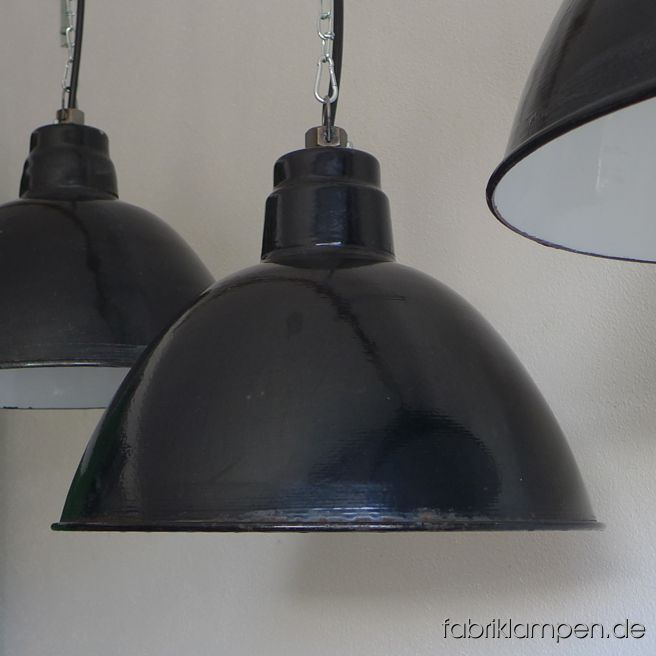 Old black enamel LBD loft lamp, produced by Leuchtenbau Dresden. The lamps have the typical traces of usage and age. Material: black (inside white) enameled steel sheet. Newly electrified, with E27 ceramic sockets. Height of the lamp ca. 29 cm (11,4 inches), diameter of the shade ca. 42 cm (16,5 inches).