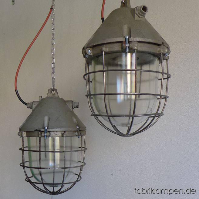 Big aluminium bunker lamps. Material: pale gray varnished casing, safety glass and grid. Cleaned, preserved, newly electrified, with E40/E27 or with E27 sockets. We have 35 pieces on stock. Height of the lamps ca. 42 cm (16,5 inches), diameter of the lamps ca. 30 cm (11,8 inches), weight ca. 7,3 kgs, the lamps are relatively light.