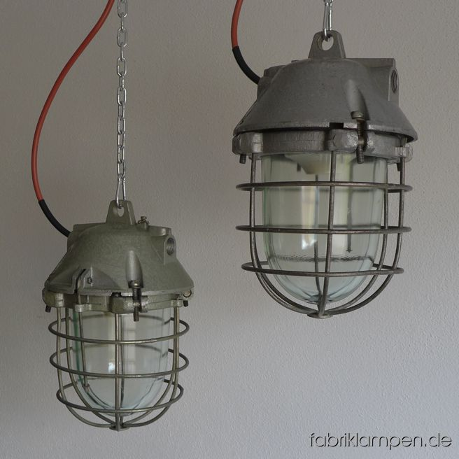 Rare smaller aluminium bunker lamps in pale green or gray. Material: pale green gray varnished casing, safety glass and grid.  Newly electrified, with E27 sockets. We have 15 pieces on stock. Height of the lamps ca. 35 cm (13,8 inches), diameter of the lamps ca. 20 cm (7,9 inches).