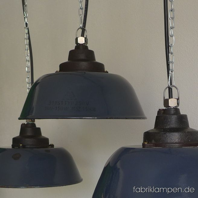 Old blue factory lamp with enameled shade. Material: blue enameled sheet, casted iron head, with traces of age and use. Newly electrified, with E27 sockets. We have 8 pieces on stock. Height of the lamps ca. 20,5 cm (8 inches), diameter of the shades ca. 36 cm (14,2 inches).