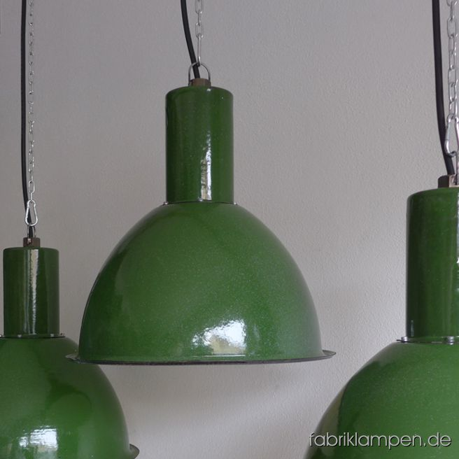 Old green enamel factory lamps. The lamps have the strong traces of usage and age. Material: green (inside white) enameled steel sheet. Newly electrified, with E27 ceramic sockets. We have 10 pieces on stock. Height of the lamps ca. 39 cm (15,3 inches), diameter of the shades ca. 40 cm (15,7 inches).