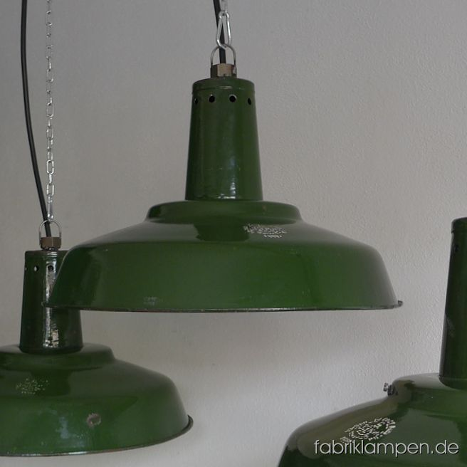 Old green enamel industrial lamps with hallmark. The lamps have the strong traces of usage and age. Material: green (inside white) enameled steel sheet. The neck is perforated (for ventilation/cooling), inside with holders (for glass – the lamps well be shipped without glass). Newly electrified, with E27 ceramic sockets. We have 7 pieces on stock. Height of the lamps ca. 30 cm (11,8 inches), diameter of the shades ca. 46 cm (18,1 inches). We have also the smaller version in stock: diameter 39 cm (15,3 inches), height 24 cm (9,4 inches).