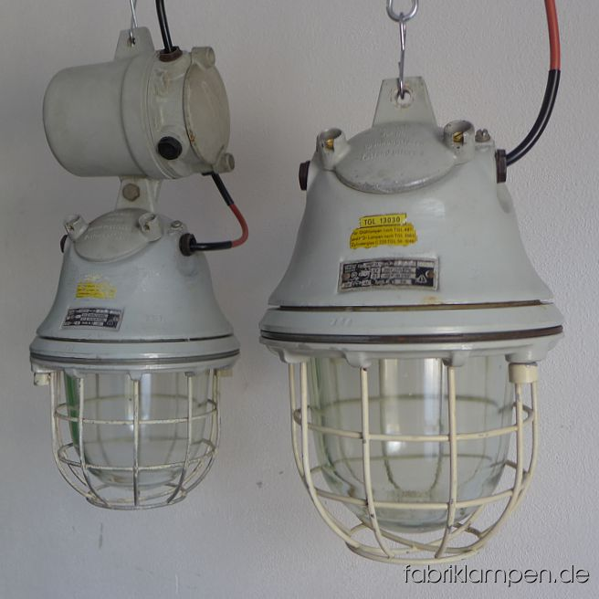 Old EOW bunker lamps. The lamps have the traces of usage and age. Material: aluminium casing, safety glass and steel grid. Cleaned and newly electrified, with E27 ceramic sockets. We have 12 pieces on stock, between 2 lamps with distribution box. Height of the lamps ca. 40 cm (15,7 inches), height with distribution box ca. 60 cm (23,6 inches), diameter of the lamps ca. 26 cm (10,2 inches).