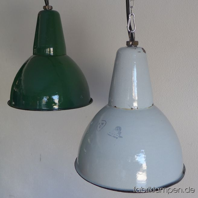 Old green and pale gray enamel factory lamps. The lamps have the strong traces of usage and age. Material: green (inside white) enameled steel sheet. Clenad and newly electrified, with E27 ceramic sockets. We have 7 pieces in stock. Height of the lamps ca. 33 cm (13 inches), diameter of the shades ca. 31,5 cm (12,4 inches).