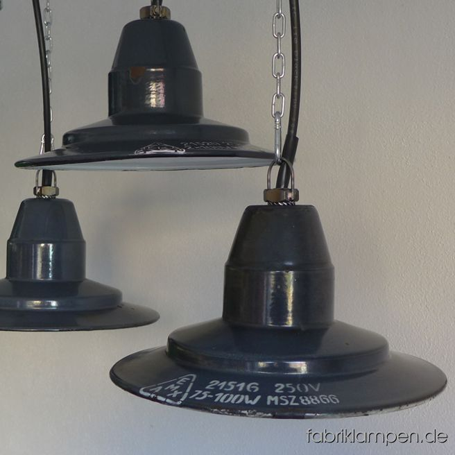 Very rare old enamel factory lamps from different periods of the same manufacturer (EKA, afterwards EMAX), from the 1940ies up to he end oft he 1950ies. The lamps have the partly strong traces of usage and age. Material: grayish blue  (inside white) enameled steel sheet. Cleaned, newly electrified, with E27 ceramic bulbholders. Height of the lamp is ca. 15 cm (5,9 inches), diameter of the shade is ca. 30,5 cm (12 inches).