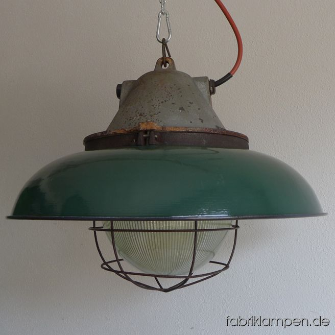 Very rare big bunker lamp with green enamel shades. It belongs to the biggest coloured enamel lamps, the diameter of the shade is 52 cm (20,5 inches), the lamp weighs 15 kgs. The lamps have the traces of age and usage. Material: casted iron top, safety glass and grid, green (inside white) enameled steel sheet. Cleaned, conserved and newly electrified, with E27 ceramic bulbholders. Height of the lamps ca. 39 cm (15,4 inches), diameter of the shades ca. 52 cm (20,5 inches).