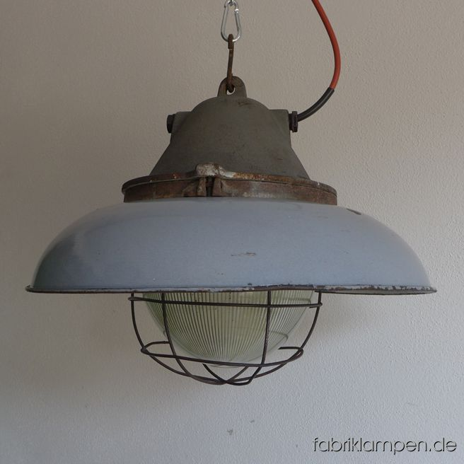 Very rare big bunker lamp with gray enamel shades. It belongs to the biggest coloured enamel lamps, the diameter of the shade is 52 cm (20,5 inches), the lamp weighs 15 kgs. The lamps have the traces of age and usage. Material: casted iron top, safety glass and grid, gray (inside white) enameled steel sheet. Cleaned, conserved and newly electrified, with E27 ceramic bulbholders. Height of the lamps ca. 39 cm (15,4 inches), diameter of the shades ca. 52 cm (20,5 inches).