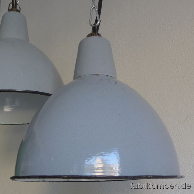 Rare old pale gray enamel lamp. The lamps have the traces of usage and age. Material: pale gray (inside white) enameled steel sheet. Clenad and newly electrified, with E27 ceramic sockets. We have only 2 pieces in stock. Height of the lamps ca. 23 cm (9 inches), diameter of the shades ca. 31 cm (12,2 inches).